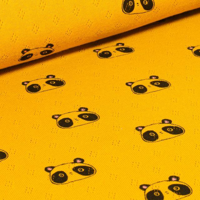 Tissu Jersey ajouré  Têtes de Pandas sur fond Jaune