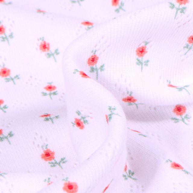 Tissu Jersey ajouré Petites fleurs sur fond Blanc