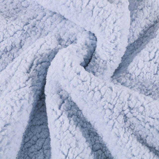 Fausse fourrure mouton Bleu ciel - Par 10 cm