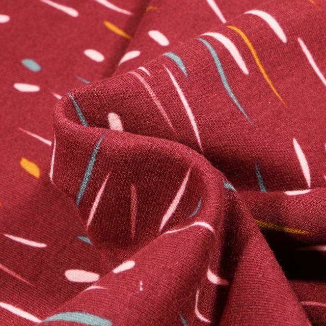 Tissu Jersey Coton envers molletonné Bio Pluie colorée sur fond Bordeaux