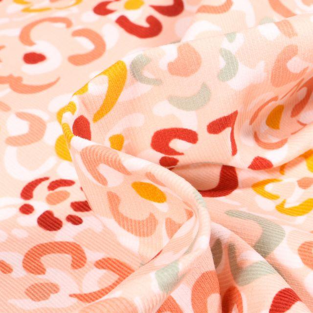 Tissu Velours milleraies Fleurs colorées sur fond Saumon