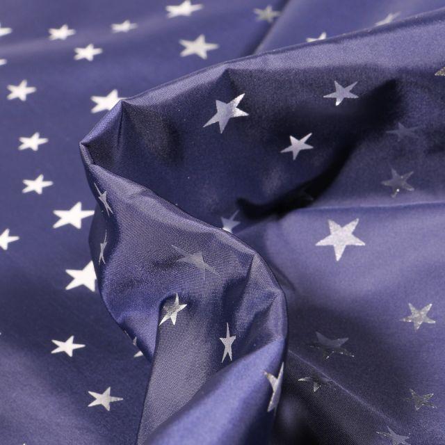Tissu Déperlant k-way Etoiles argentées sur fond Bleu marine