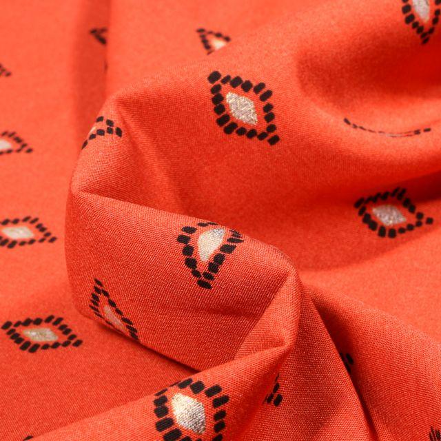 Tissu Viscose Losanges ethniques dorés sur fond Orange
