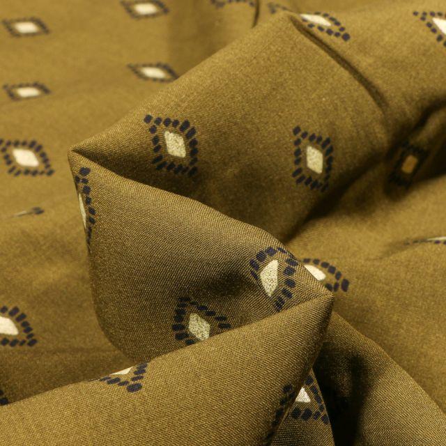 Tissu Viscose Losanges ethniques dorés sur fond Vert kaki