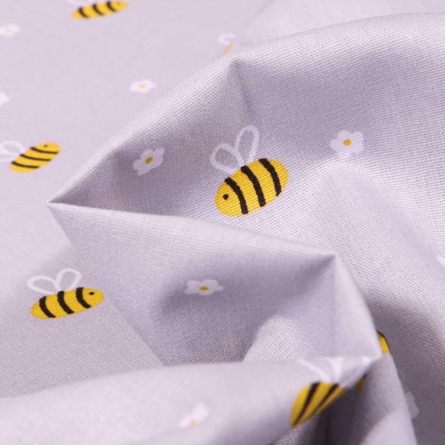 Tissu Coton imprimé Abeille et petites fleurs sur fond Gris