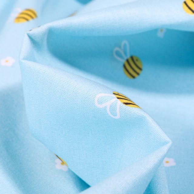 Tissu Coton imprimé Abeille et petites fleurs sur fond Bleu