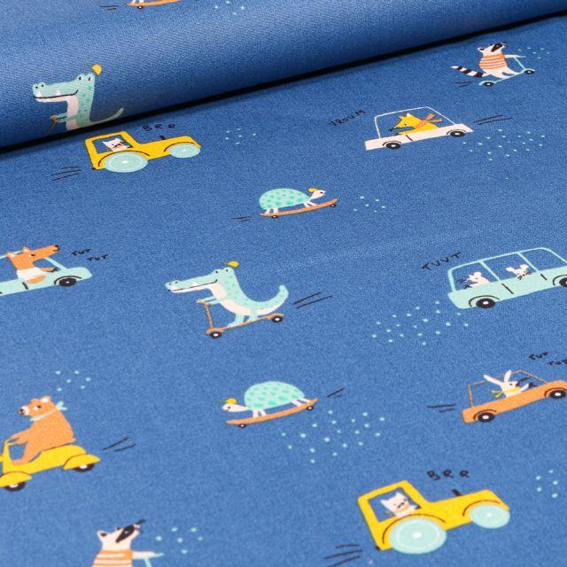 Tissu Coton imprimé Animaux skate et trottinette sur fond Bleu