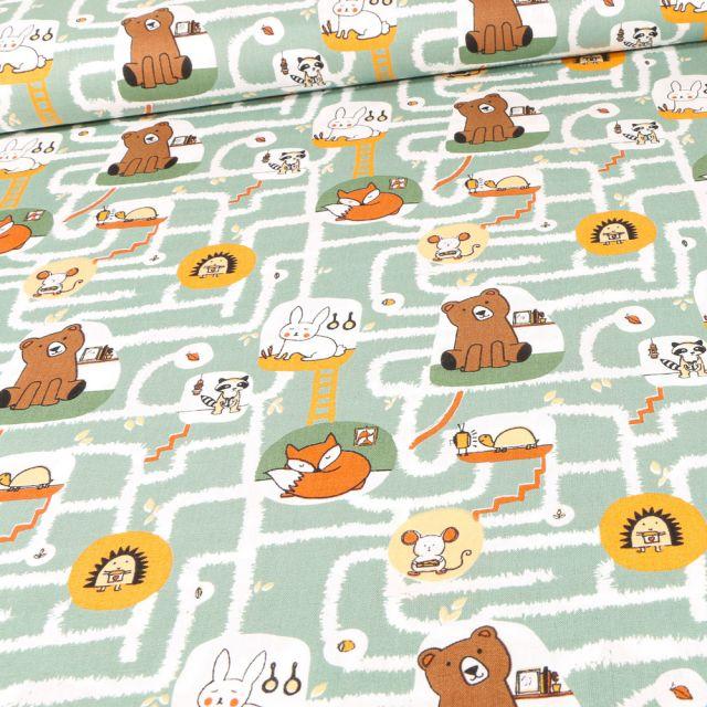 Tissu Coton imprimé Bio Labyrinthe et animaux sur fond Vert amande