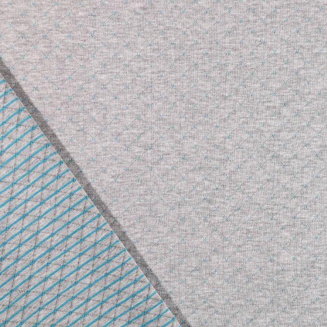 Tissu Sweat Matelassé Réversible Motifs turquoise sur fond Gris clair chiné - Par 10 cm