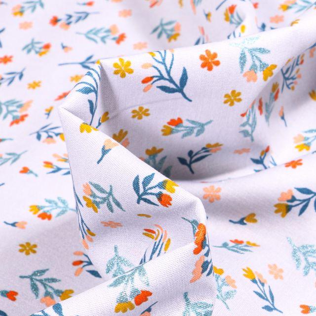 Tissu Coton imprimé  Lia sur fond Bleu ciel
