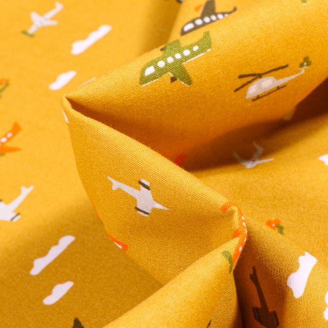 Tissu Coton imprimé Transports aériens sur fond Jaune