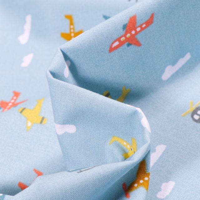 Tissu Coton imprimé Transports aériens sur fond Bleu ciel