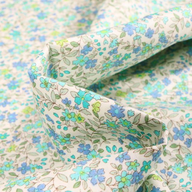 Tissu Coton popeline imprimé Florentine bleu sur fond Blanc cassé