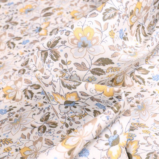 Tissu Coton popeline imprimé Julietta jaune sur fond Blanc