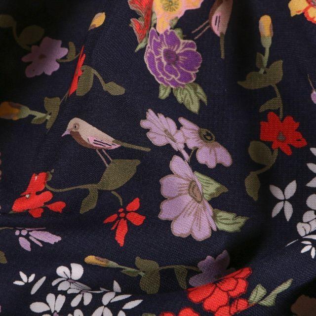 Tissu Crêpe  Fleurs et oiseaux sur fond Bleu marine - Par 10 cm