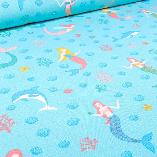 Tissu Toile de Coton Ottoman Sirènes et dauphins sur fond Bleu turquoise