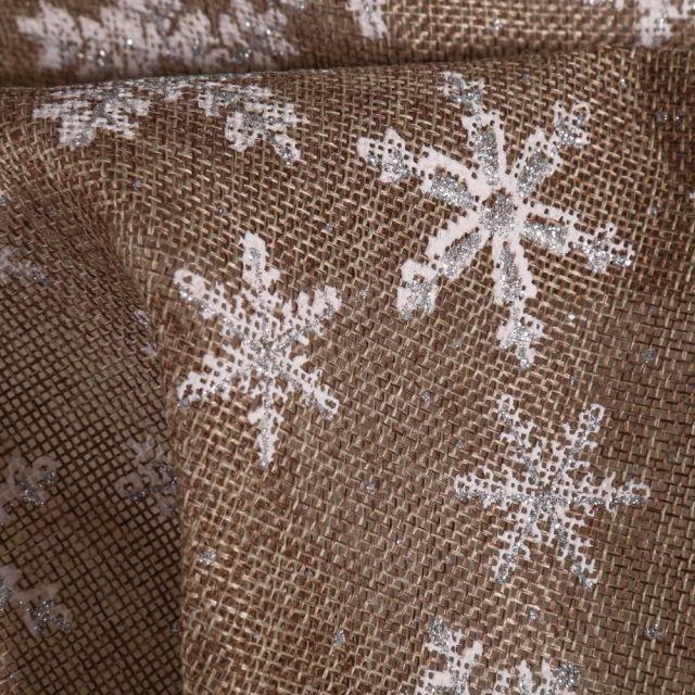 Tissu Toile de jute  Flocons blancs sur fond Naturel - Par 10 cm