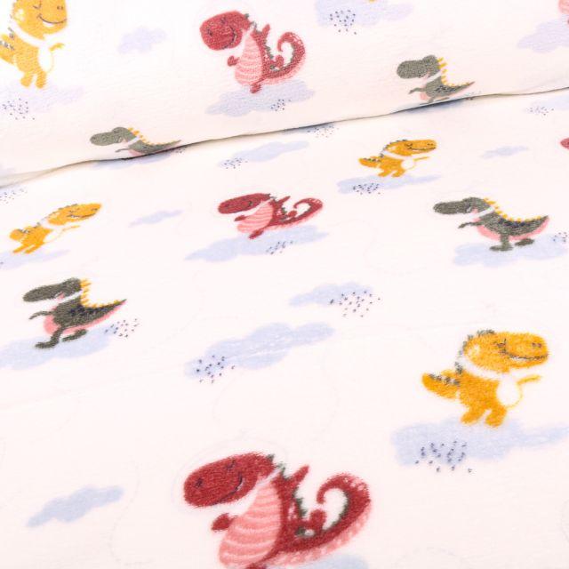 Tissu Doudou Dragons multicolores sur fond Blanc