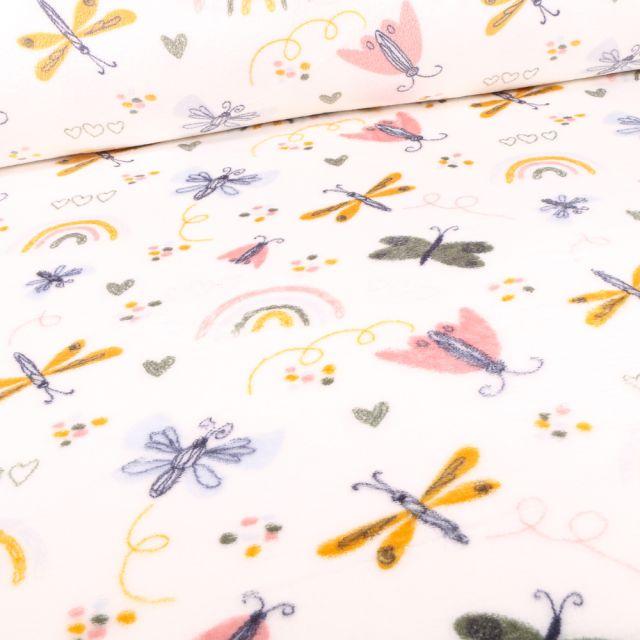 Tissu Doudou Libellules et papillons sur fond Blanc cassé