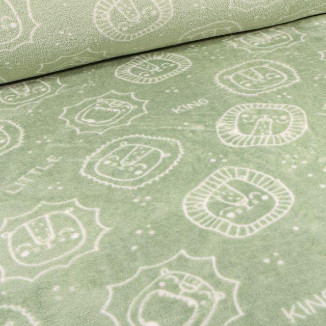 Tissu Doudou Têtes de lions sur fond Vert amande