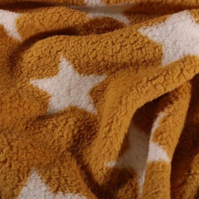 Fausse fourrure mouton Etoiles blanches sur fond Jaune moutarde - Par 10 cm
