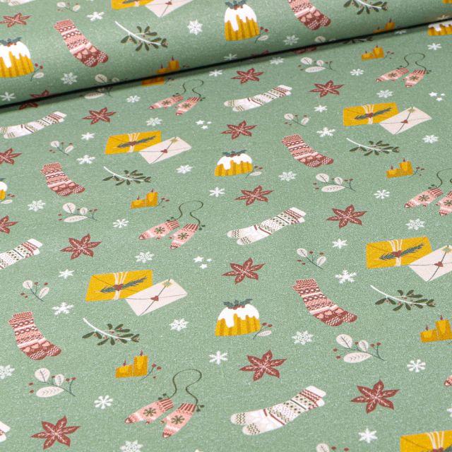 Tissu Coton imprimé Bio Motifs de noël sur fond Vert amande