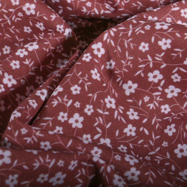 Tissu Popeline Coton Bio Petites fleurs blanches sur fond Parme - Par 10 cm
