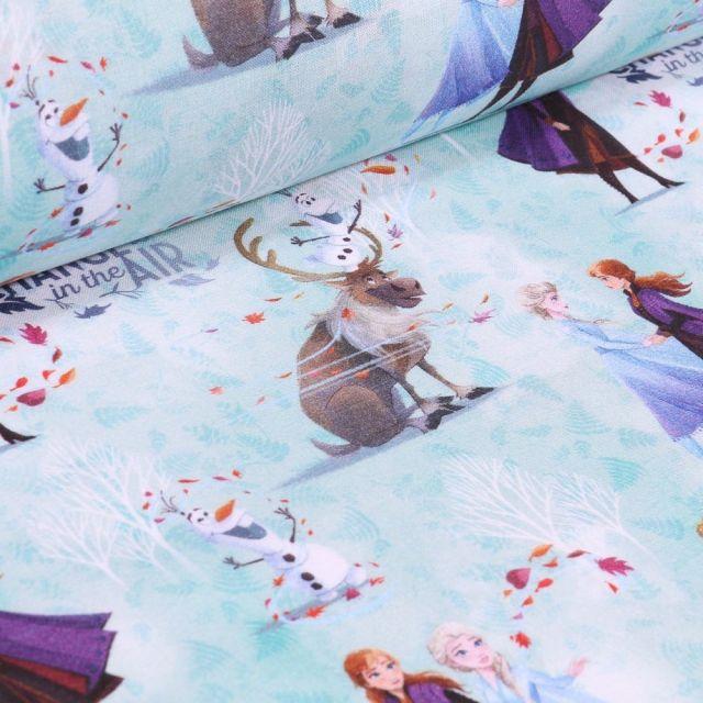 Tissu Coton imprimé sous licence Bio La reine des neiges Anna et Sven sur fond Bleu lagon - Par 10 cm