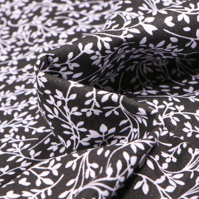 Tissu Coton MC Fabrics Feuillages blancs sur fond Noir