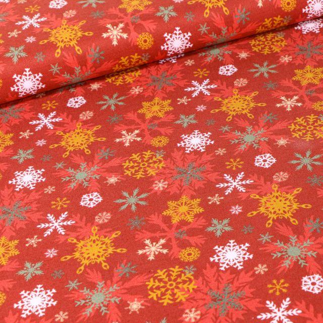 Tissu Coton imprimé Bio Flocons colorés sur fond Rouge