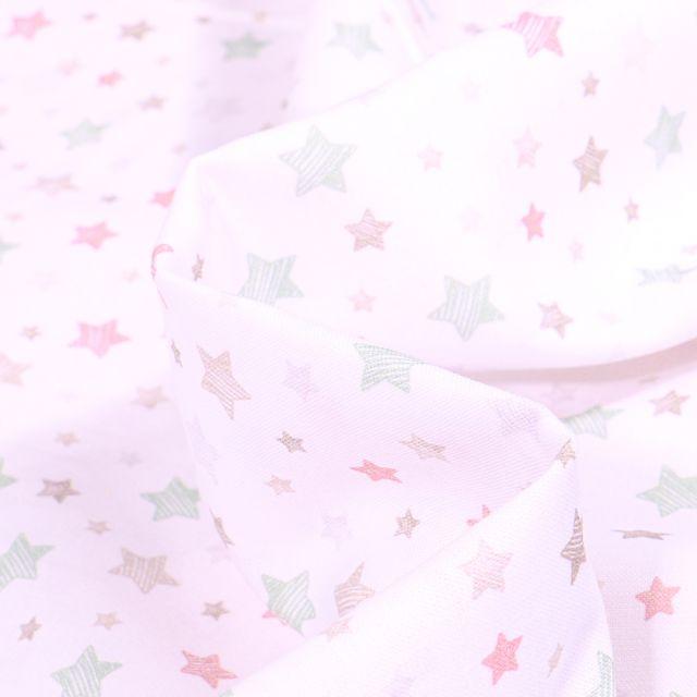 Tissu Coton imprimé Bio Etoiles pastels sur fond Blanc