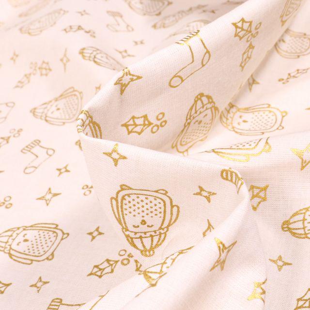 Tissu Coton imprimé Bio Pingouins dorés sur fond Blanc cassé