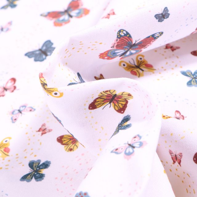 Tissu Coton MC Fabrics Papillons multicolores sur fond Blanc