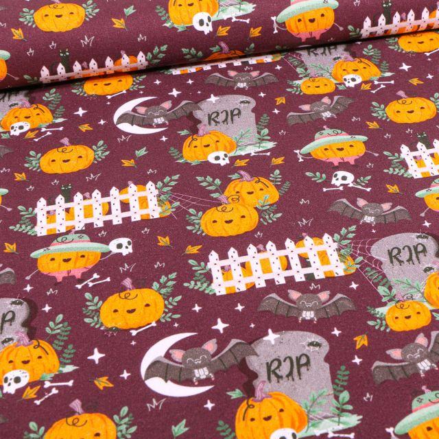 Tissu Coton imprimé Bio Citrouilles et chauves souris d'halloween sur fond Bordeaux