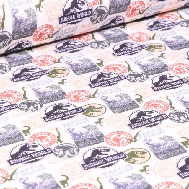 Tissu Coton imprimé sous licence Bio Jurassic World Logo sur fond Blanc cassé