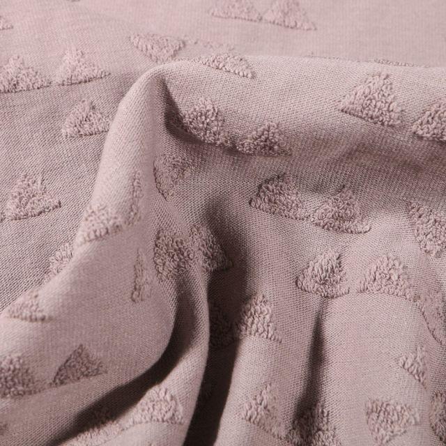 Tissu Jersey Coton Triangles en relief sur fond Taupe - Par 10 cm