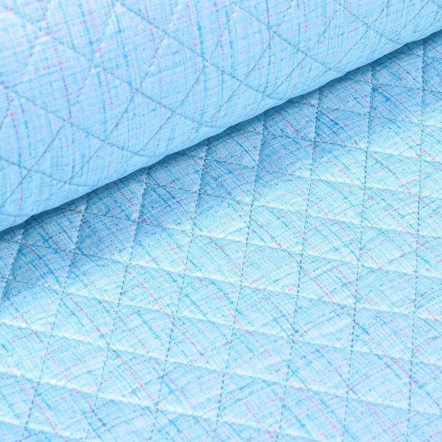 Tissu Doudoune matelassé London Chiné sur fond Bleu - Par 10 cm