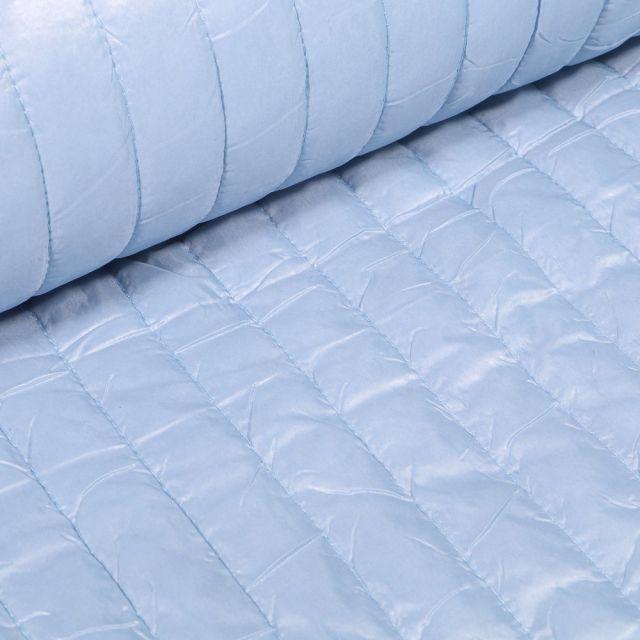 Tissu Doudoune matelassé rayé Bleu ciel - Par 10 cm