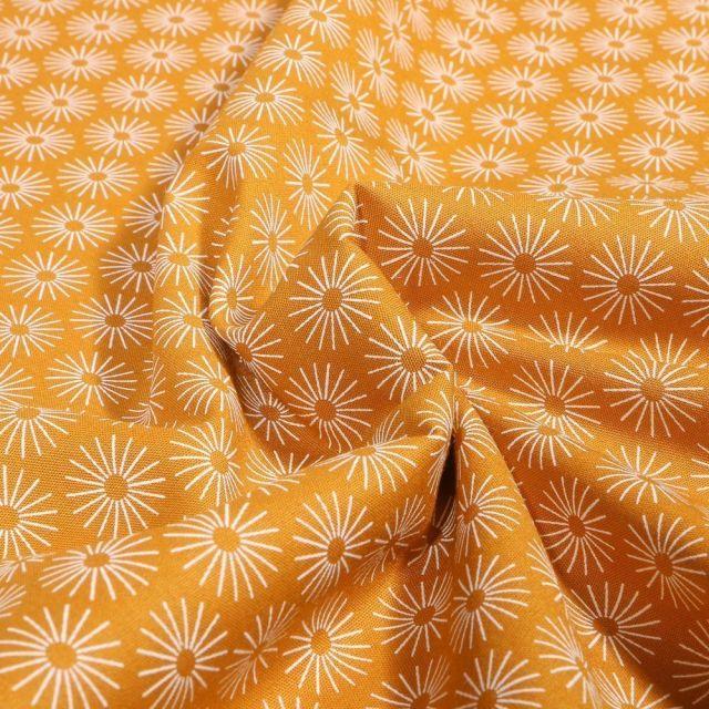 Tissu Coton imprimé Soleils stylisés sur fond Ocre - Par 10 cm