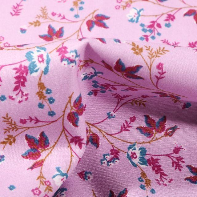 Tissu Coton imprimé Kimy sur fond Rose - Par 10 cm