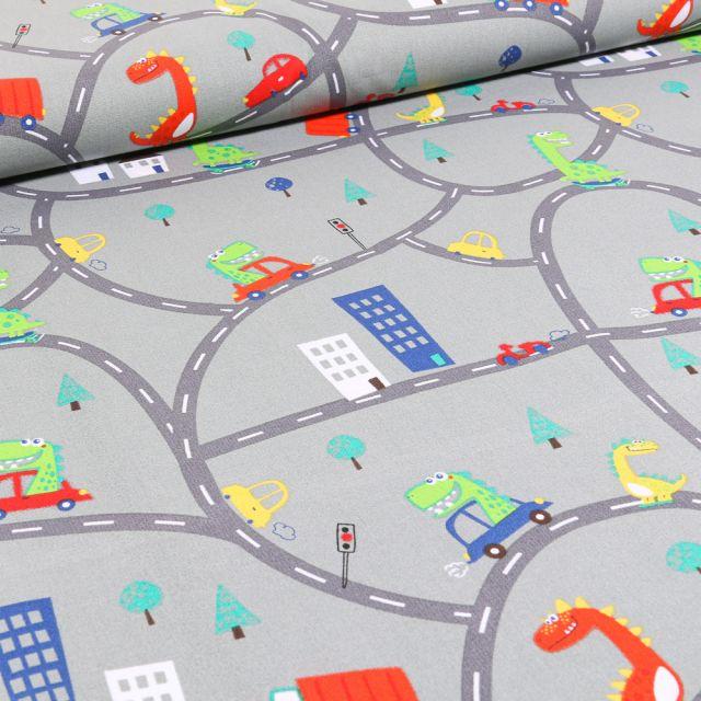 Tissu Coton imprimé Dinosaures en ville sur fond Gris