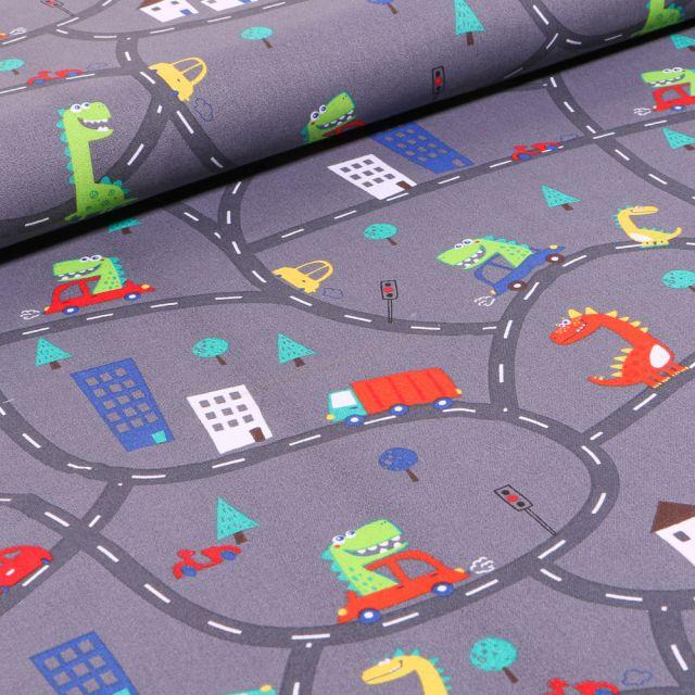 Tissu Coton imprimé Dinosaures en ville sur fond Gris anthracite