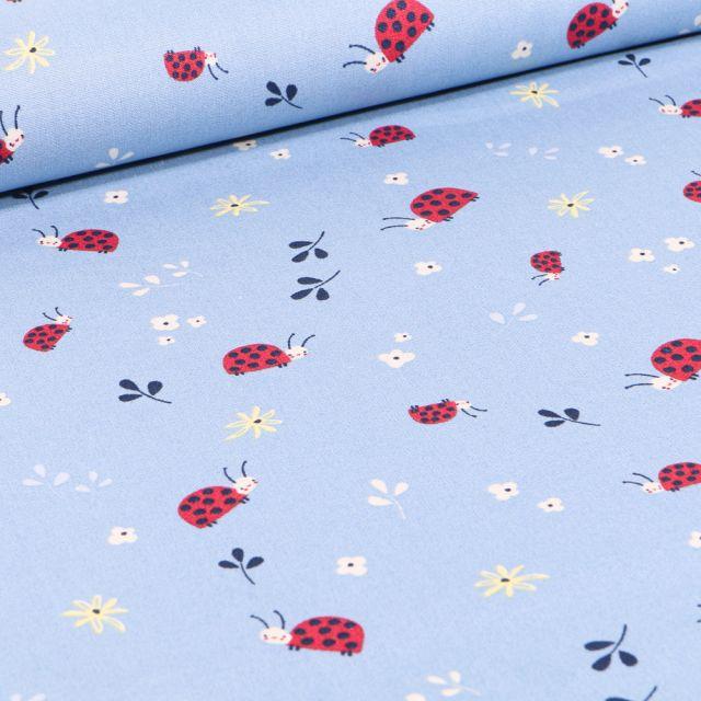 Tissu Coton imprimé LittleBird Coccinelles et fleurs sur fond Bleu