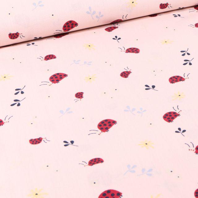 Tissu Coton imprimé LittleBird Coccinelles et fleurs sur fond Rose nude