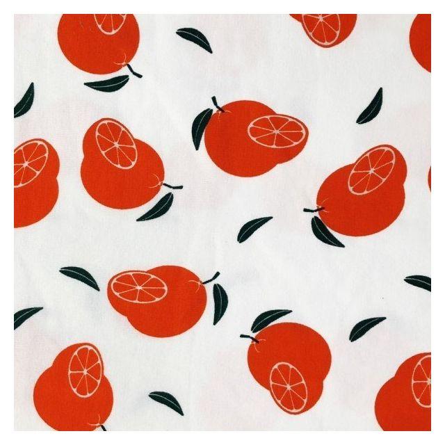 Tissu Jersey Coton parfumé saveur Orange sur fond Blanc - Par 10 cm
