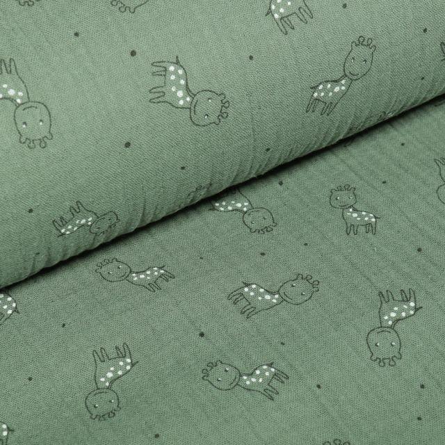 Tissu Triple gaze Girafe sur fond Vert amande