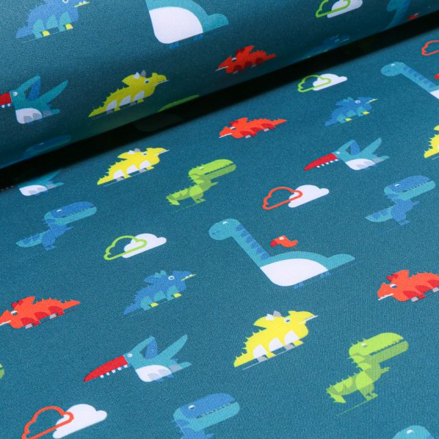 Tissu Softshell Dinosaures sur fond Bleu pétrole