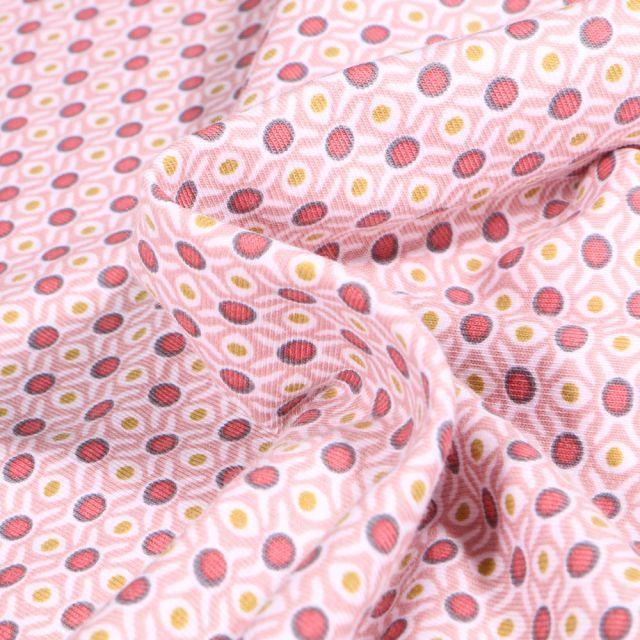 Tissu Jersey Coton Bio Alvéoles et pois sur fond Rose pâle