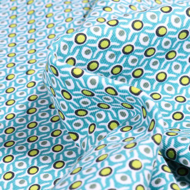 Tissu Jersey Coton Bio Alvéoles et pois sur fond Bleu turquoise