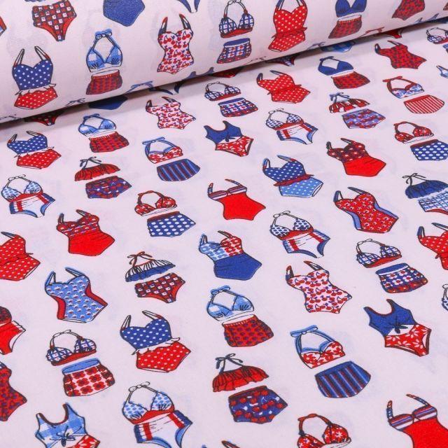Tissu Coton enduit Maillots de bain bleus et rouges sur fond Blanc - Par 10 cm